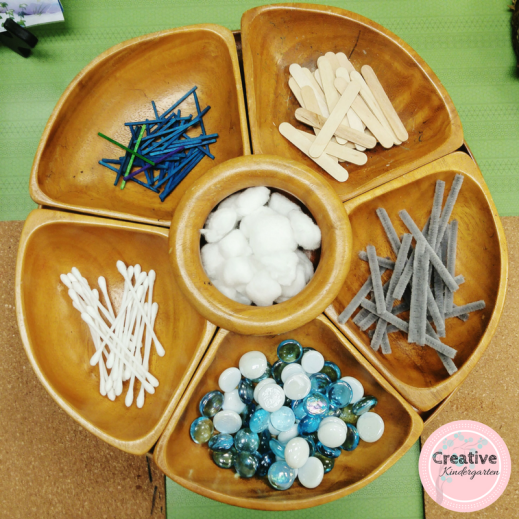 Loose parts for creating snowflakes in kindergarten.