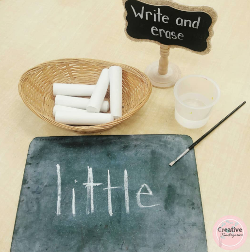 Easy, no prep sight word center for kindergarten students. Write sight word in chalk, then use a paintbrush dipped in water to paint over it.