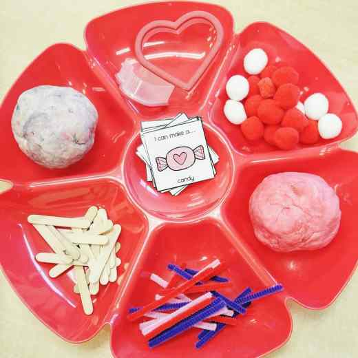 Play dough invitation to create with task cards, pompoms, pipe cleaners, cookie cutters and mini popsicle sticks