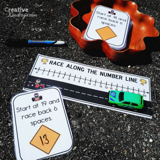 Race Along the Number Line kindergarten math center for reinforcing adding and subtracting skills. A fun, play-based activity that is perfect for practicing addition and subtraction skills.