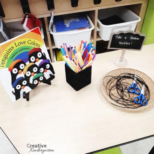 Fine Motor center for kindergarten. Make a rainbow necklace using straws and scissors.
